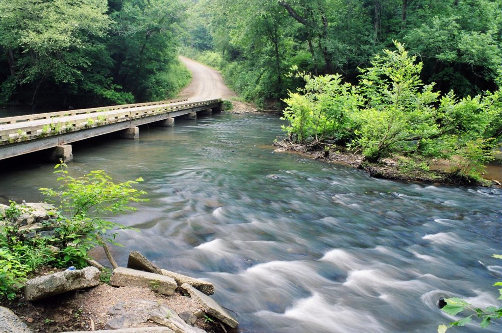 Bridge over rushing waters in Uwharrie National Forest