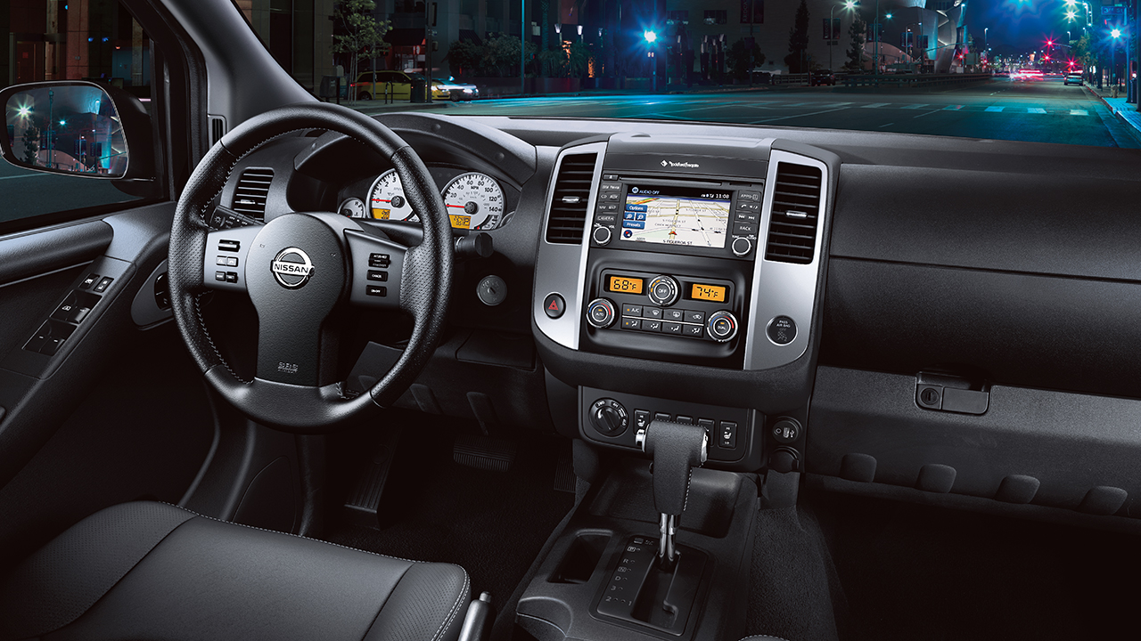 The front row in the cabin of a 2017 Nissan Frontier.