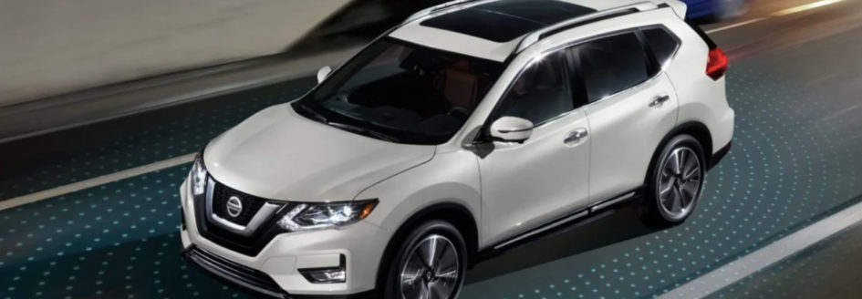 White 2019 Nissan Rogue surrounded by Nissan Intelligent Mobility lights