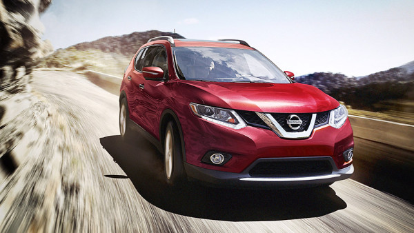 Red 2016 Nissan Rogue driving off road