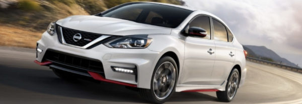 White 2019 Nissan Sentra driving mountain highway